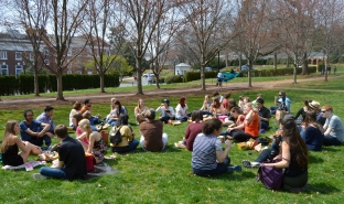 The Tribe and UVa students enjoy a picnic in the shadow of the Rotunda at the University of Virginia.